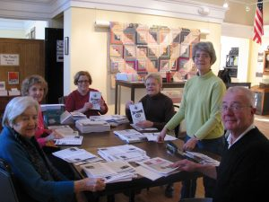 Volunteers working on a mailing