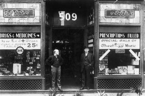 Joseph and George Varden in front of Varden's Drugs